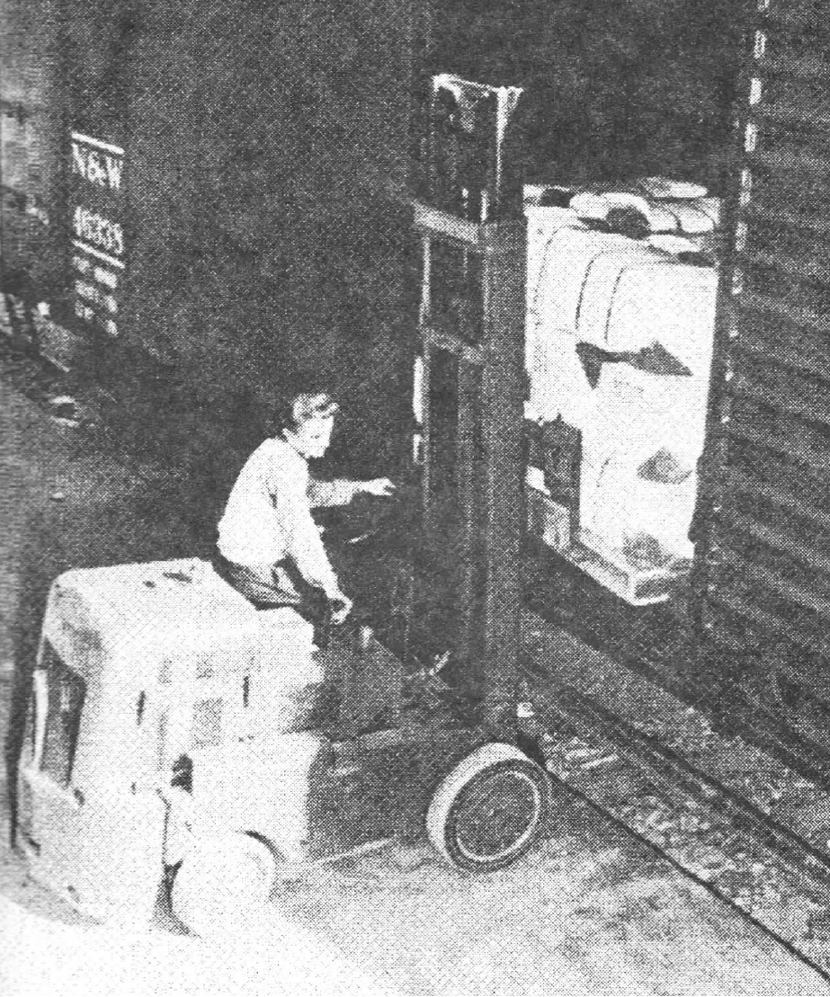 Lift truck loading of bailed uniforms during WWII