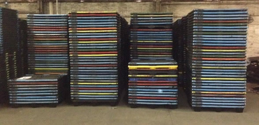 stacks used plastic pallets