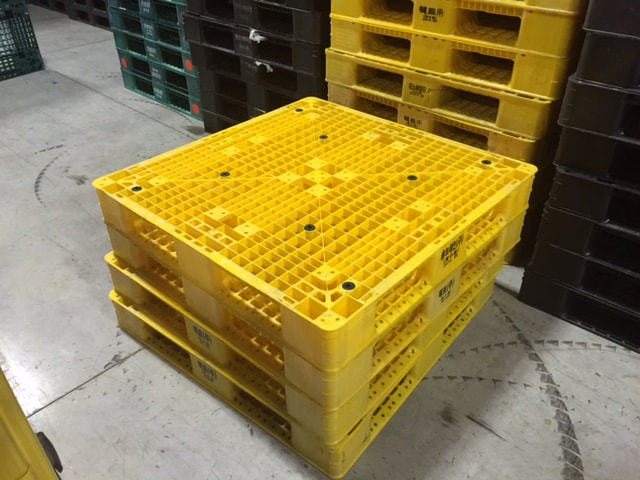 yellow plastic pallets